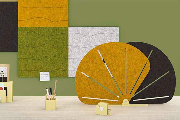 Ecran Butterfly et panneaux Swell au mur dans les tons vert et jaune